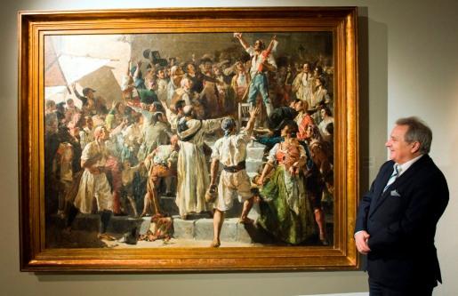 El presidente de la Diputación de Valencia, Alfonso Rus, observa el cuadro de Sorolla El Palleter declarando la guerra a Napoleón (1884) / Foto: Abulaila-Diputación de Valencia